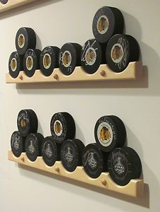 Hockey Puck Wall Display Rackfrom Happy Stick Displays. I think these are good for hockey tape storage too...