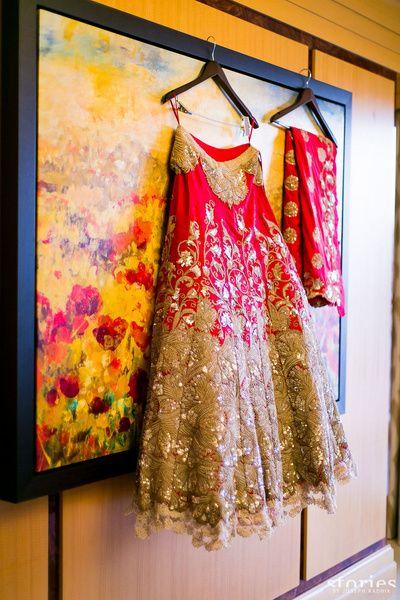 Bridal Wear - Anamika Khanna Bridal Outfit | WedMeGood | Red Bridal Lehenga with Golden Lace Embroidery and Resham Work #wedmegood #indianbride #indianwedding #red #lehenga #bridallehenga #dupatta