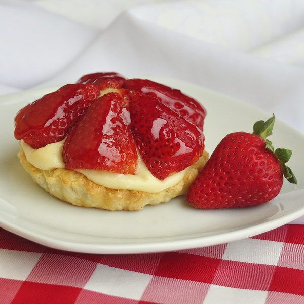 Strawberry Timtarts for Canada Day or the 4th of July! Imagine surprising your family and guests at this weekend's celebration with a homemade version of this Canadian old-time Tim Horton's favorite. Add blueberries with the strawberries for our American friends and they are also perfect for 4th of July. Check out the old TV commercial on the recipe page too.