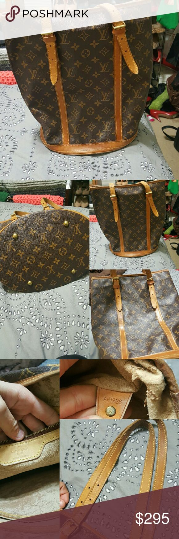 Authentic Louis Vuitton bucket bag GM firm price! Authentic Louis Vuitton bucket bag GM size. This is a vintage bag and the exterior of it looks very good. The straps are in good condition and the exterior and bottom of the bag are also in good condition. The inside of the bag is peeling as bucket bags have been known to do from Louis Vuitton. It could be taken to a Louis Vuitton store or you could even remove the parts that are peeling yourself. Please ask any questions. Does not come with…