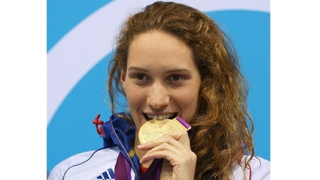 Gold medallist Camille Muffat of France poses on the podium during the VictoryCeremony following the women's 400m Freestyle final on Day 2 of the London 2012 Olympic Games at the Aquatics Centre.