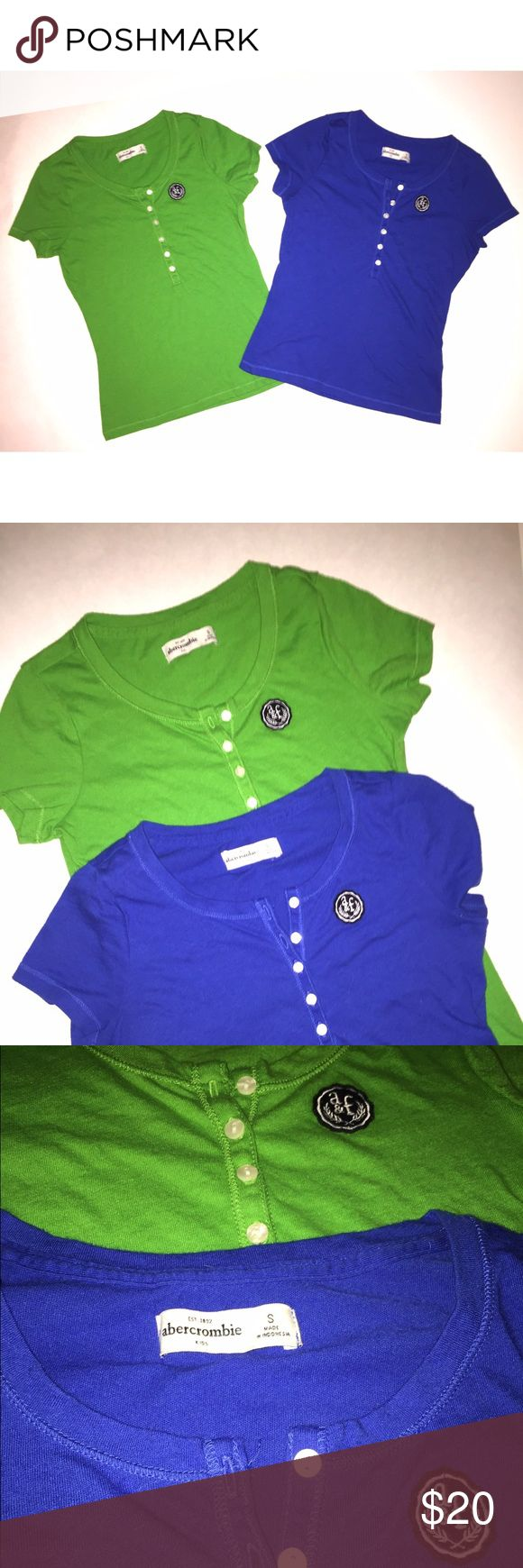 🌸Abercrombie Kids🌸 Bundle of 2 Short Sleeve Tops 🌸Abercrombie Kids- Bundle of 2 t-shirts size S 🌸Great pre-loved condition. Mild/typical signs of wear and fading. No stains or holes unless noted.                                                                                                       🌸1 royal blue and 1 green- short sleeve- button front Henley styling                                                             🌸Happy Poshing! abercrombie kids Shirts & Tops Tees - Short…