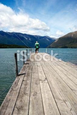 Man on Lake Rotoiti Jetty, Nelson Lakes National Park Royalty Free Stock Photo