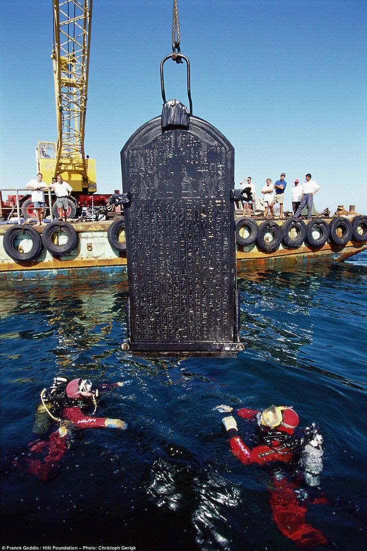 Reclaimed: The intact Stele of Thonis-Heracleion, is pictured being carefully lifted out of the Nile delta. The inscription makes clear that it was to be placed on the site of Heracleion, a city thought lost to the sands of time, and helped archaeologists be sure that they had found the right place
