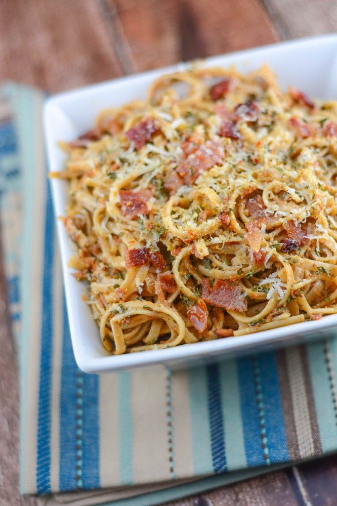 Sun-Dried Tomato Pesto Pasta is spaghetti (or angel hair pasta) with Sun-Dried Tomato Pesto, sprinkled with bacon, parmesan cheese, black pepper, and parsley. Quick, easy, and delicious.