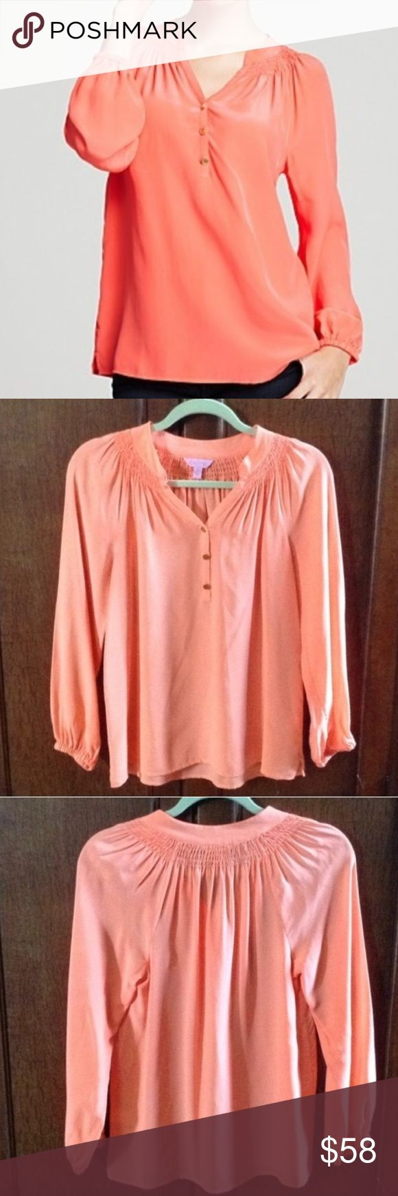"Lilly Pulitzer Elsa 100% Silk ""Sunset Orange"" Top Loose fitting long sleeve blouse with smocking at the neck.   100% silk.   Color is ""Sunset Orange"", which is more coral than orange.   Excellent overall condition.  Shoulder to shoulder approx 16"" across when flat, armpit to armpit 17.5"", sleeve 23"", length 25.5"". Measurements are approximate. Lilly Pulitzer Tops Blouses"