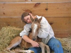 Miree, 5 days old, with her owner/breeder Becky Stanfield Burkheart of The Original Series.
