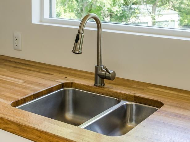 The Future of Homebuilding: Style With Sustainability : The countertop is made from a reclaimed-oak truck bed that was originally the floor of a tractor trailer truck. From DIYnetwork.com