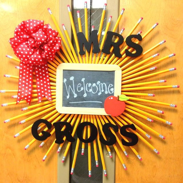 Back to school wreath for my classroom door. I used the directions from http://organizeyourstuffnow.com/wordpress/pencil-and-cork-wreath and added some of my own touches.