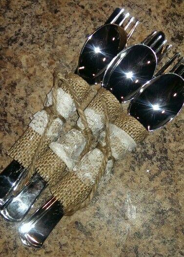 DIY wedding reception silverware. Dollar tree silver plastic silverware wrapped in burlap & lace tied tied with twine:)