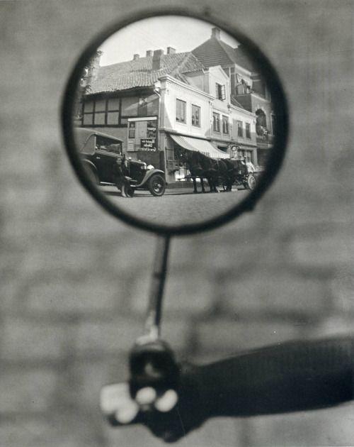 Martin Munkácsi: Reflection in a motorcycle mirror, Berlin, c. 1929