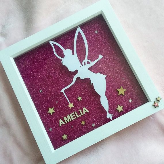 Personalised Handmade Tinkerbell Name Frame  Personalised Birthday, Christening, Girls Box Frame - Gift or Keepsake  These beautiful hand made frames are perfect for childrens bedroom or playroom and can be personalised with your little ones name :) Each frame features a papercutting of Disneys Tinker Bell handout by myself, along with wooden star and pink gem embellishments. The papercutting is set upon a sparkly purple background or I have bright pink or baby pink if you would prefer :)…