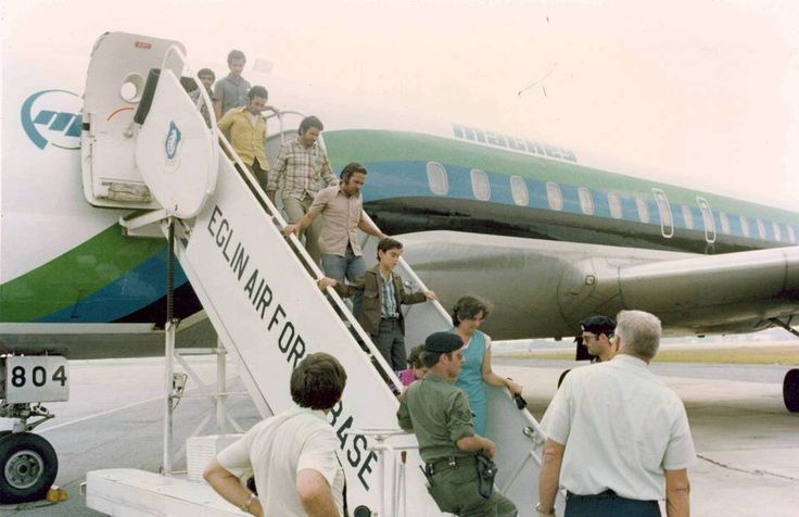 Group of Cubans are flown from Key West to Eglin Air Force Base in the Florida Panhandle.