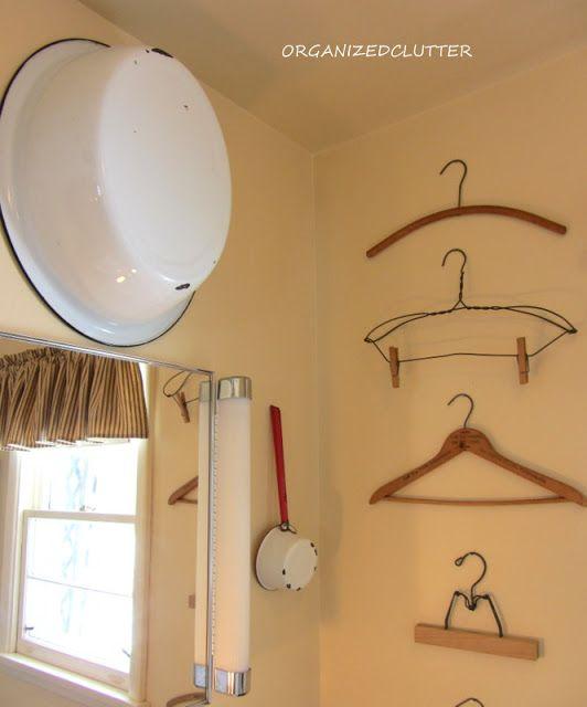 Decorating a very small bathroom coats wall