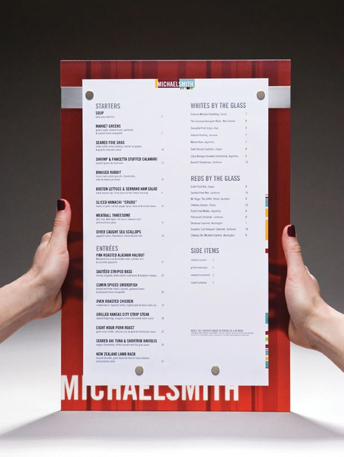 Michael Smith Restaurant Design Menu - Unique menu design idea. I like how the name of the restaurant is at the bottom, but it's cut off by the menu. It looks like the material is semi-transparent which can indicate the restaurant is more upscale.
