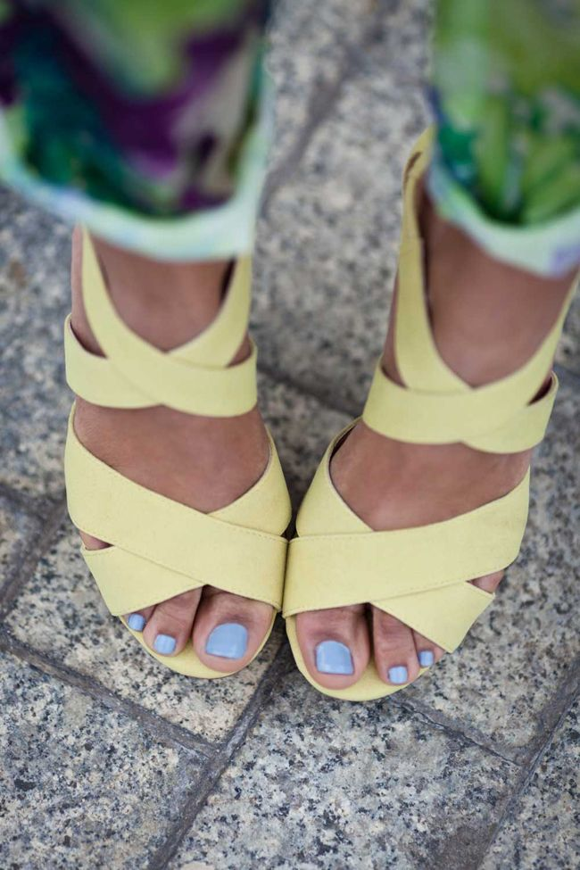 Match bright yellow sandals with an equally fun nail color