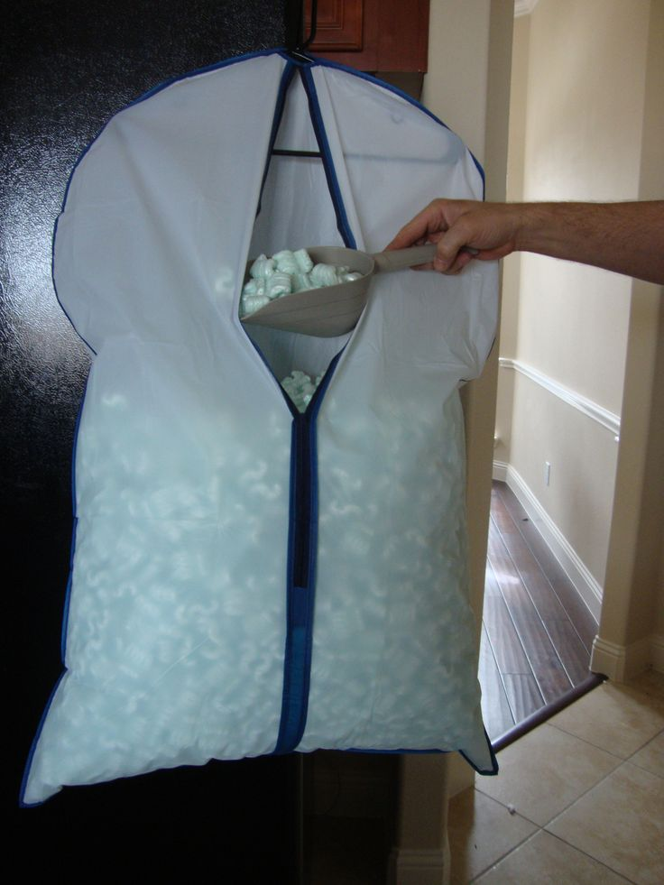 Take a suit or outfit garment from the dollar store put a hanger in it, stuff it with packing peanuts a scooper that I found at the dollar store and viola you have your own packing station for all of our great shipping needs, can substitute with bubble wrap, whatever you desire.
