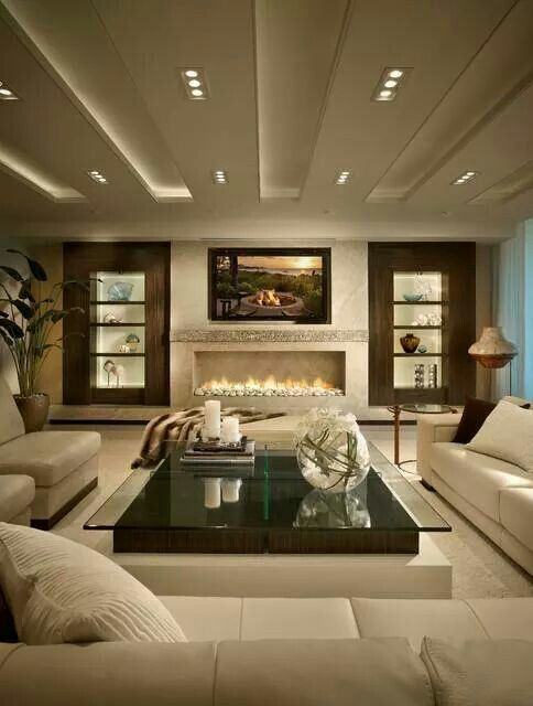 Love the wide glass fireplace, so crisp looking!