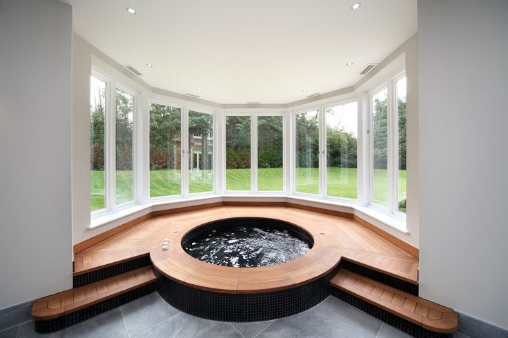 Ceiling downlights echo the shape of this octagonal spa area.  They are set back for as low glare as possible for those using the pa.