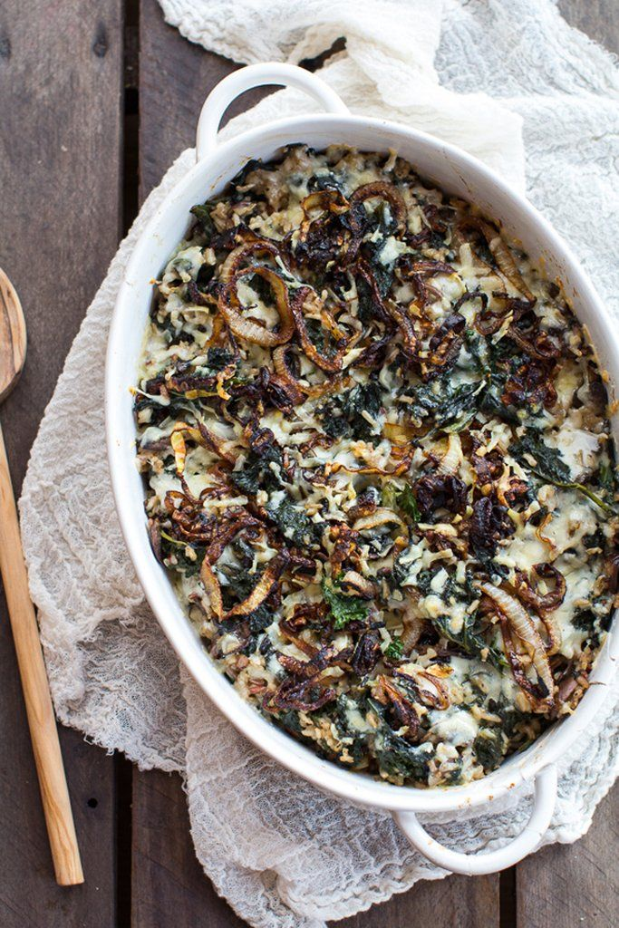 Gruyère, mushrooms, and caramelized onions add umami oomph to a kale and wild rice casserole. Reheat a left...