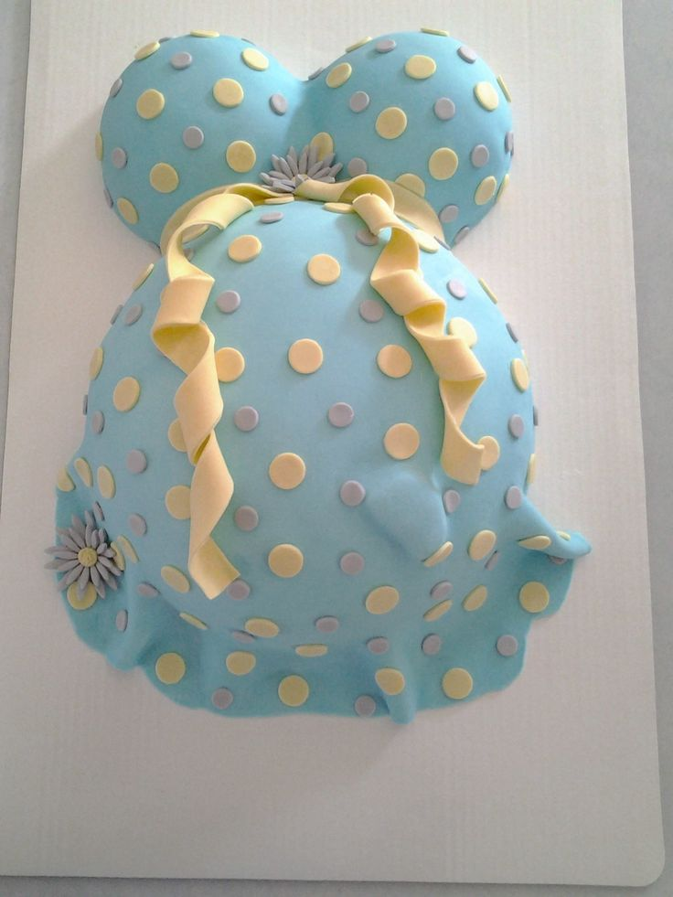 Pregnant belly cake. Lemon cake and chocolate cake