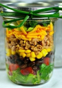 Taco salad in a mason jar- because somewhere along the way, glass replaced shells in tastiness.