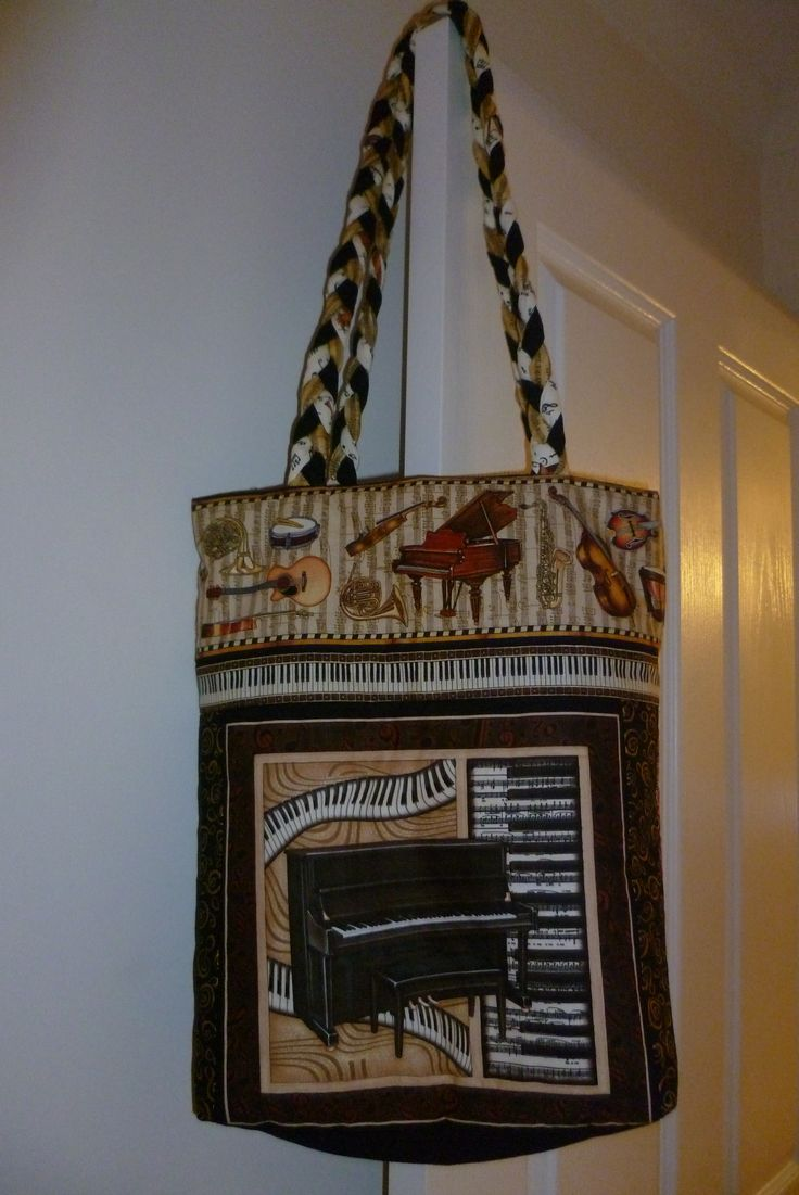 I made this music book bag from Perfect Pitch fabrics.  The Plaited fabric handles are really comfortable on the shoulder.