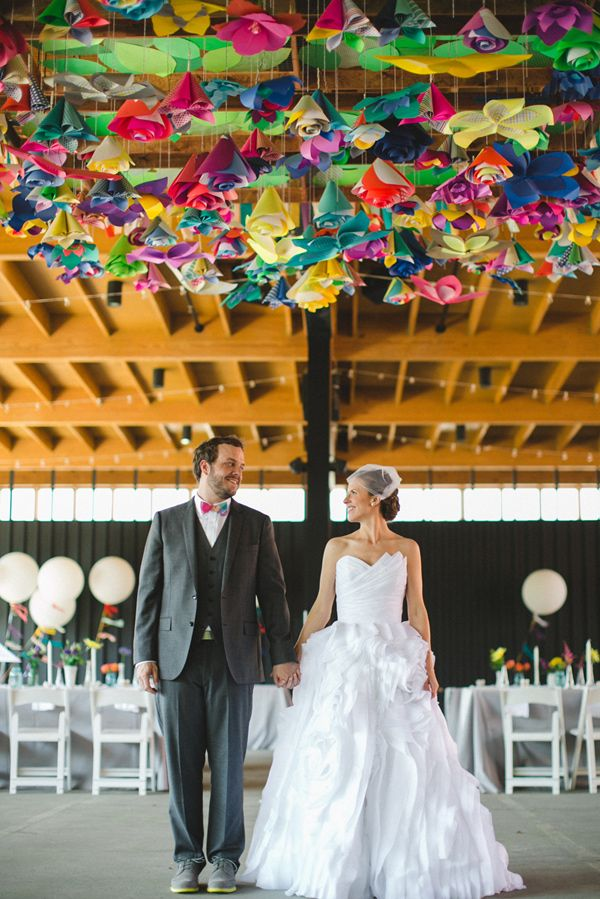 paper flower ceiling - photo by The Schultzes http://ruffledblog.com/whimsical-and-colorful-wedding-in-savannah