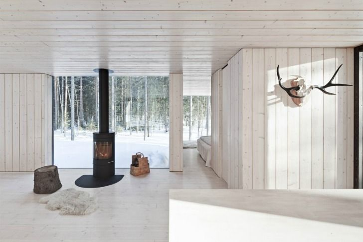 Helsinki studio Avanto Architects have completed this house with four wings overlooking four distinct views in Virrat, Finland.Called Four-Cornered Villa, the house is stained black on the outside and clad with light wood inside. The lakeside building has no running water and draws power from solar cells.