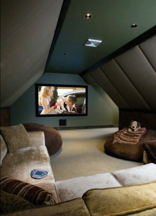 Even a small attic space can be turned into a cozy movie-viewing environment.