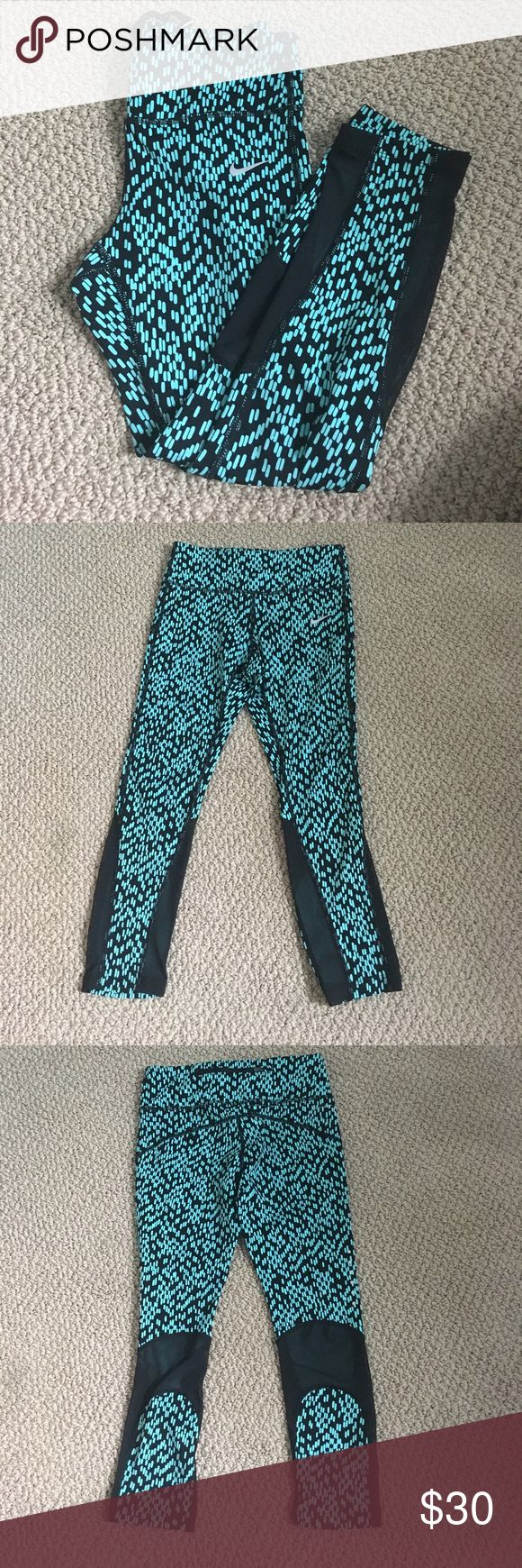 NWOT Nike cropped epic run running leggings These nike leggings have never been worn just nwot. They are in perfect condition. They have a blue and black pattern on them. They have mesh cut outs toward the bottom of the leggings. They are size XS Nike Pants Leggings