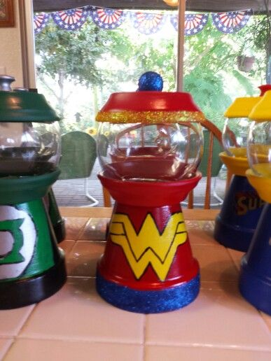 Clay pot gumball candy dish. Centerpieces for my daughter's Superhero Baby Shower.