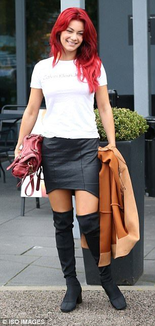 Turning heads: Dianne stood out in a leather skirt and over-the-knee boots, sporting her trademark fiery locks