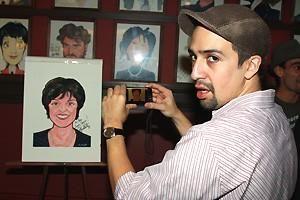 LIN-MANUEL MIRANDA (at Sardi's, taking a picture of Priscilla Lopez' caricature)