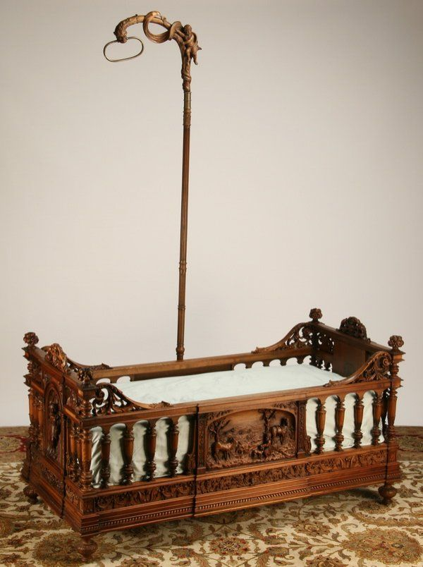 45: 19th c. carved walnut child's bed by Luigi Frullini : Lot 45