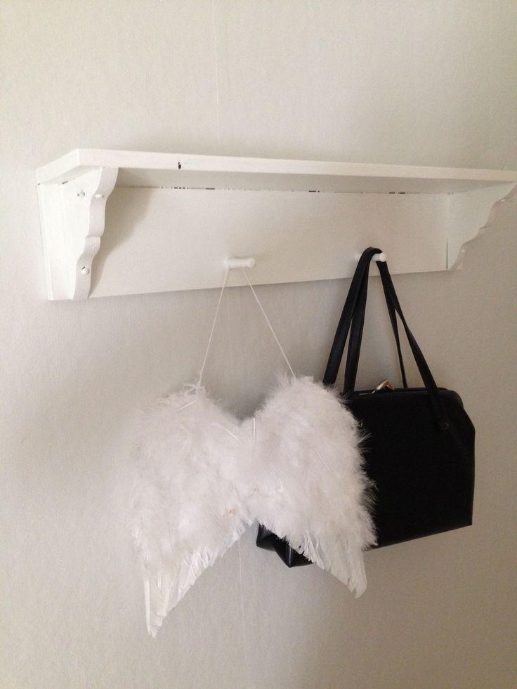 Bedroom, old white painted wall hanger, old handbag, angel wings