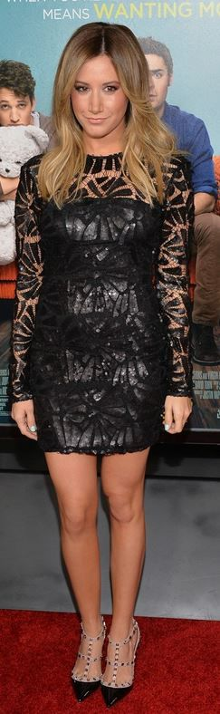 Who made  Ashley Tisdale's black long sleeve mesh dress and studded pumps?