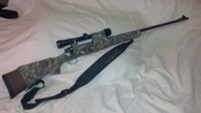 Remmington 700. Bolt acton rifle, chambered in 7mm Rem Mag. Camo covered wood stock.