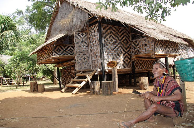 Traditional Laotian house of woven bamboo wall with geometrical pattern, Sekong province, Laos.