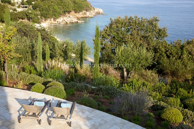 paved terrace with mounded garden and sea view