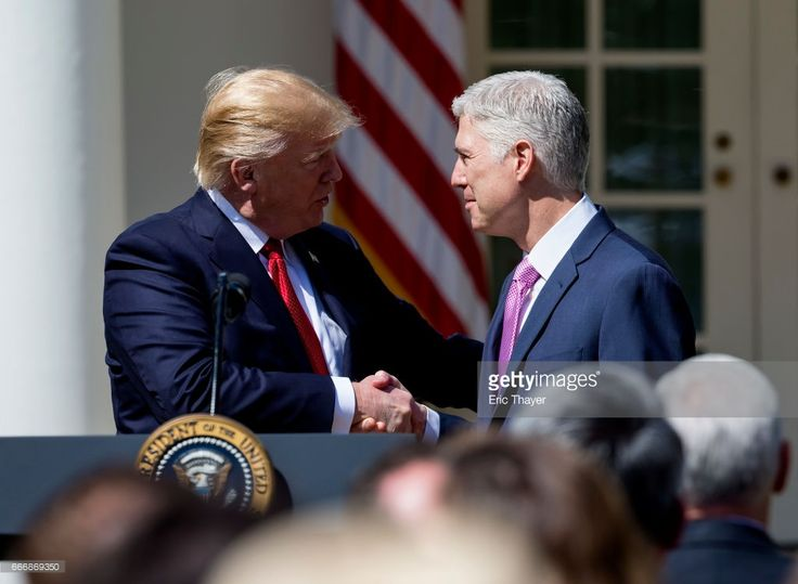 U.S. Supreme Court Justice Judge Neil Gorsuch shakes hands with President Donald Trump during a ceremony in the Rose Garden at the White House April 10, 2017 in Washington, DC. Earlier in the day Gorsuch, 49, was sworn in as the 113th Associate Justice in a private ceremony at the Supreme Court.