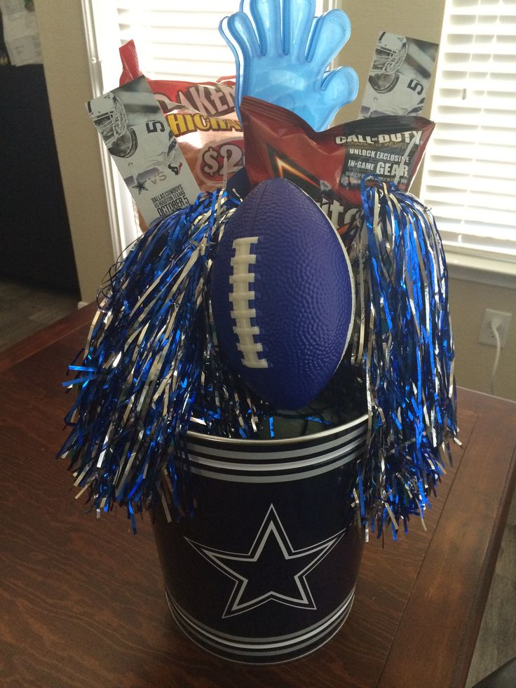 Dallas Cowboys Football gift basket I made for my boyfriends birthday! Tickets, snacks and drinks for the road trip to the stadium and of course gag gifts! He loved it!