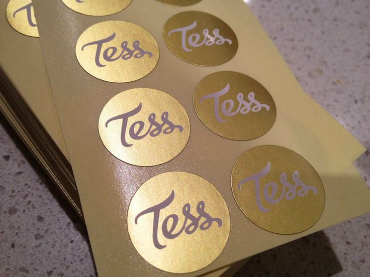 Gold foil stickers with white ink finish for photographer Tess