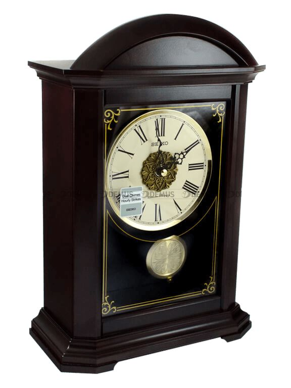 About this product   Product Identifiers     BRAND Seiko    MPN QXQ030B    Product Key Features     Age 21st Century (2000-now)    Type Mantel Clock    Style Traditional    Material Wood & Glass, Wood, Glass    Display Analogue    Movement Quartz (Battery Powered)    Features Pendulum, 12 Hour Display, Chimes, Large Display, Alarm, Clock, 12    Main Colour Brown   solit Wood   1 Year Guarantee