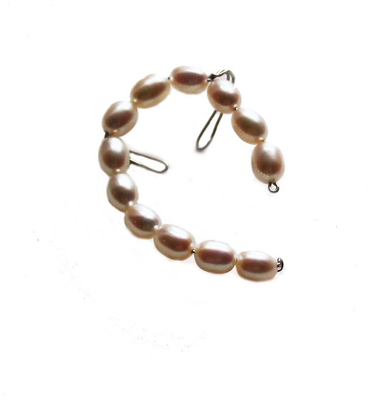 How else are you supposed to wear pearls but wrapped around your ear! Dainty and chic with a little downtown rocker edge. This perfect ear cuff is hand wired and covered in real pearls. Silver wire pe