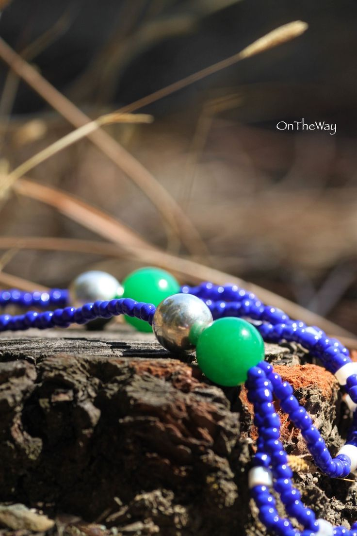 LanguWorld making jewellery. Emerald and shell with blue beads.
