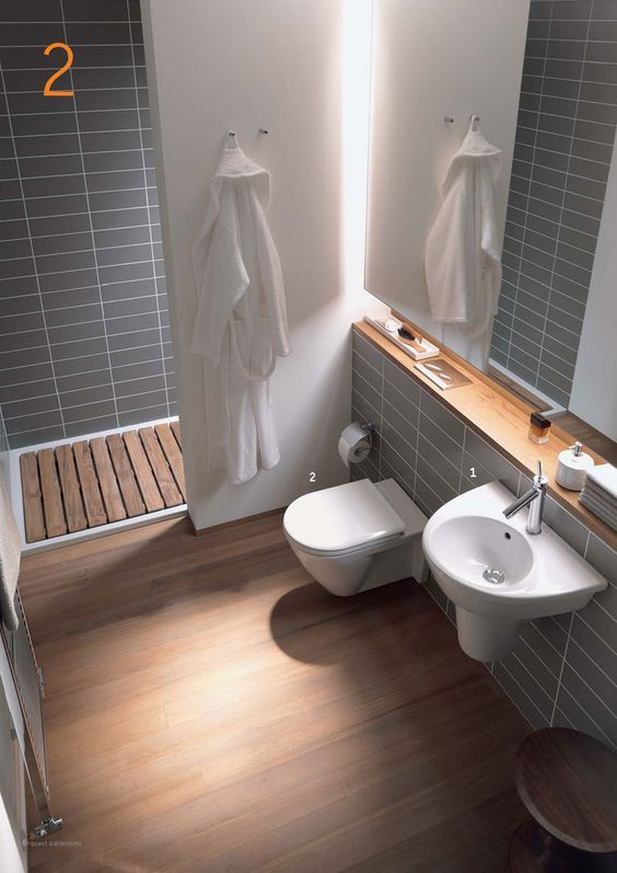 Good example of a modestly size ensuite, with a wall instead of a shower screen. disregard the wooden slats in the shower!:
