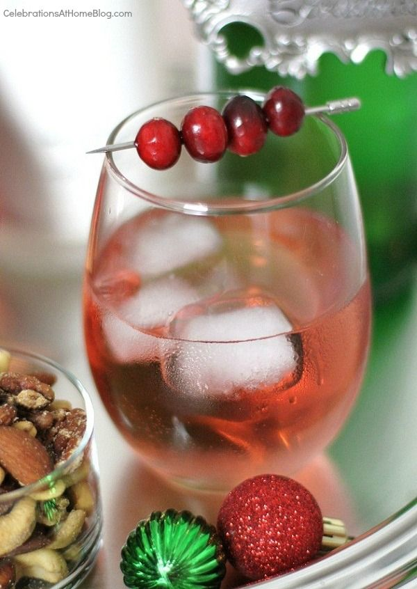 Rudolph's Shiny Red Cocktail: 3 oz Vodka, 1/2 cup Cranberry Juice, and 1/2 cup Sparkling White Grape Juice