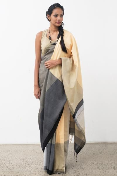Subtle colored saree with matching jacket, inspired from sand and earthy tones. Ideal for a morning occasion dress up with jewelery to look elegant.
