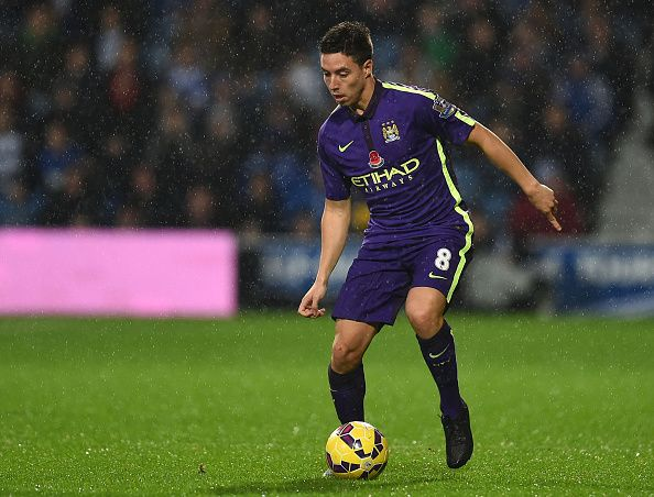 Samir Nasri of Manchester City in action during the Barclays Premier League match between Queens Park Rangers and Manchester City at Loftus Road on November 8, 2014 in London, England